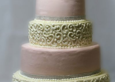 white-filigree-pink-alternating-stacked-wedding-cakes-wilmington-nc